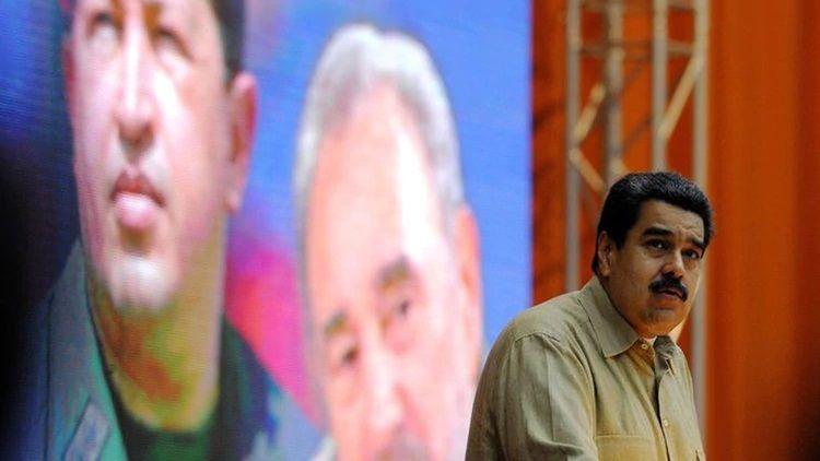 Maduro imagen Chavez y Fidel Infobae